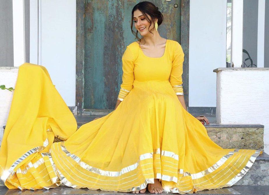 payal rajput bright yellow long flared anarkali suit