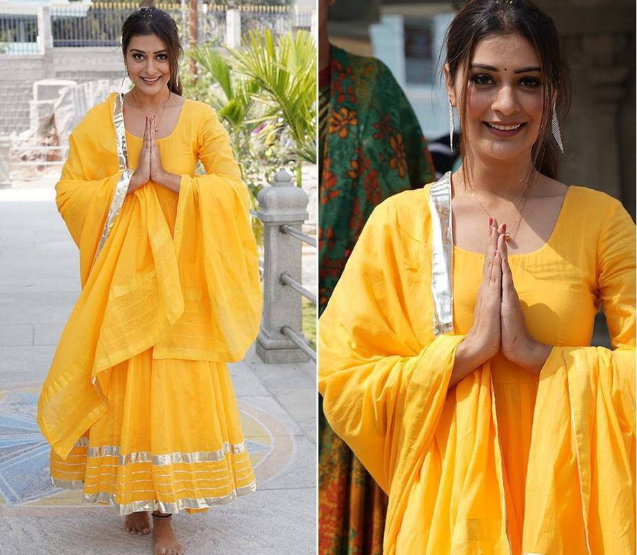 payal rajput in a bright yellow long anarkali to visit temple in hyderabad