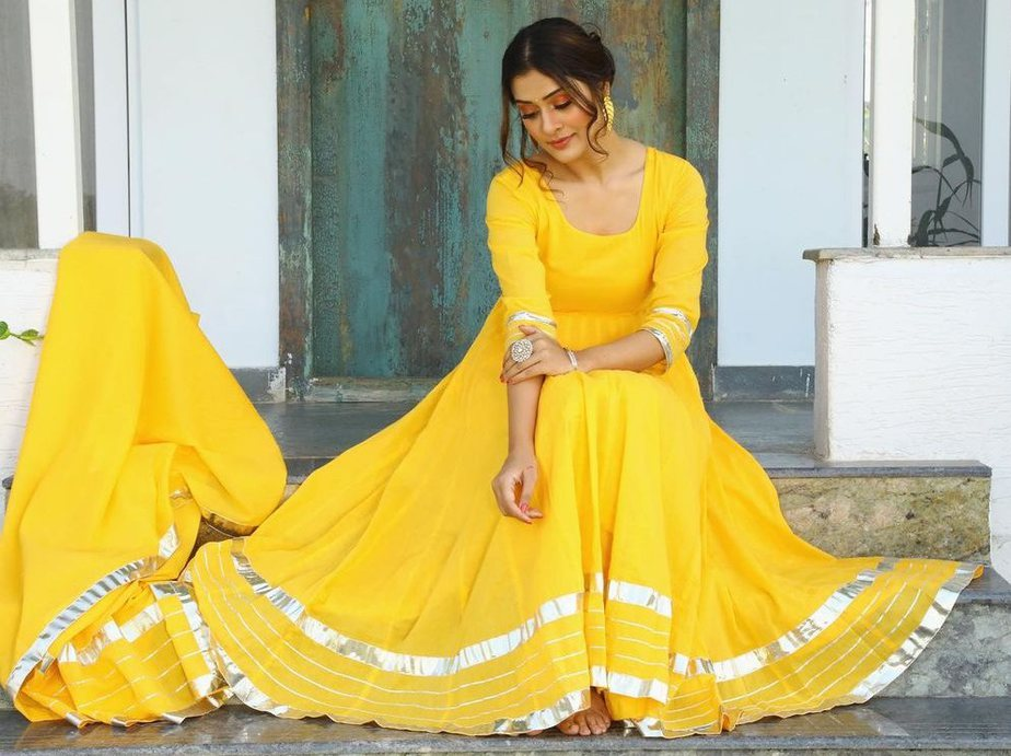 payal rajput in a yellow anarkali suit set