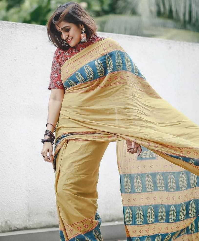 ramya Nambessan in yellow cotton saree with big earrings