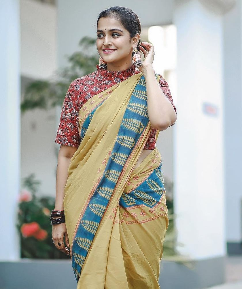 ramya nambessan in yellow cotton saree with red blouse