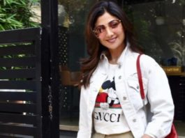 shilpa shetty in white gucci top and beige jeans