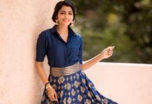 sai dhansika in a long blue skirt and shirt