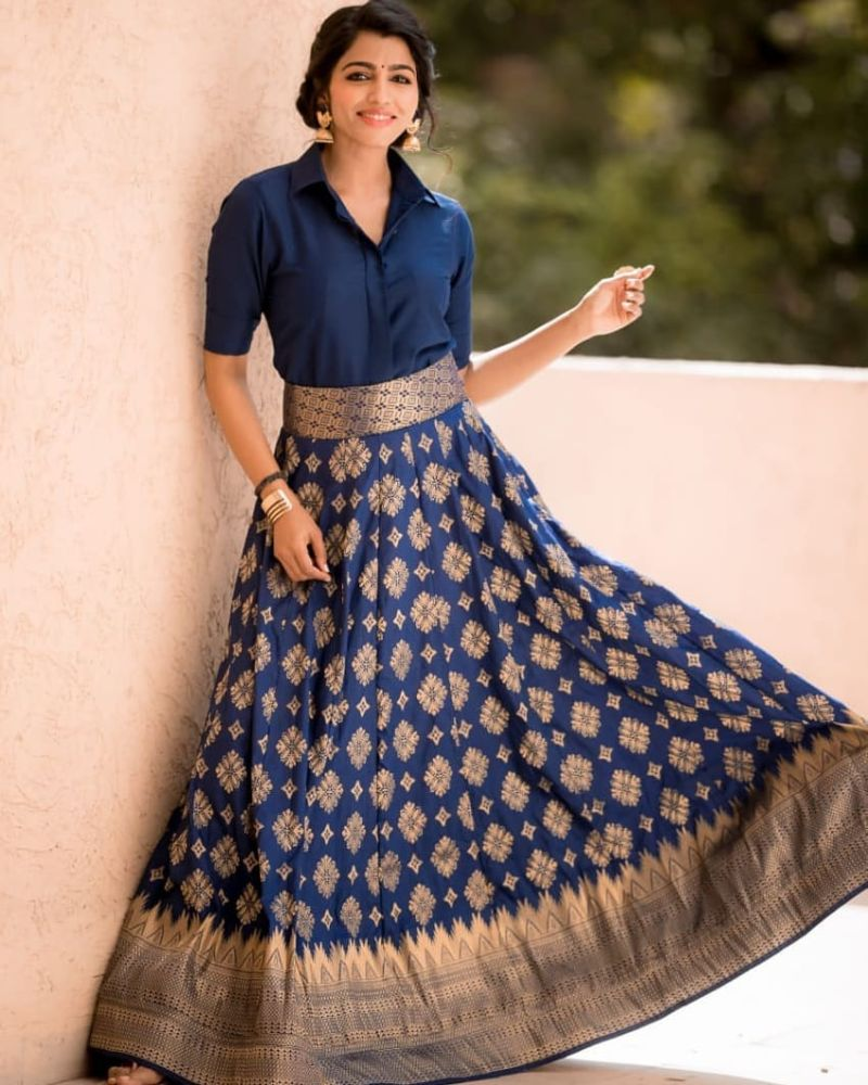 sai dhansika in a long blue skirt and shirt