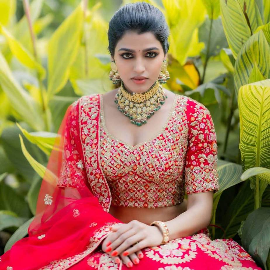 sai dhansika in red bridal lehenga varaa magazine cover shoot