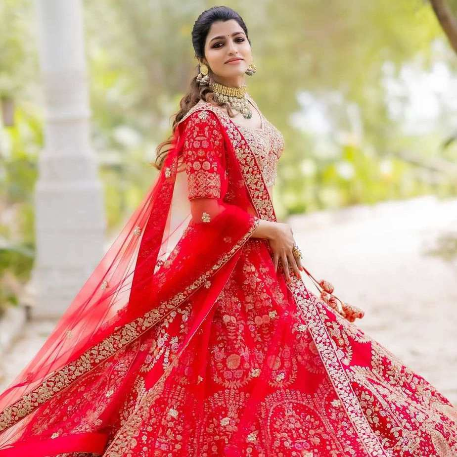 sai dhansika in red bride lehenga for varaa magazine cover shoot