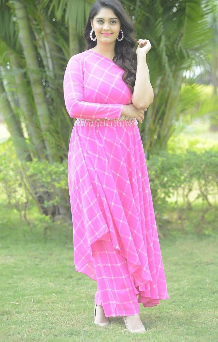 surbhi puranik pink off shoulder dress at Movie Song Okey Oka Lokam Nuvvey Success Celebrations