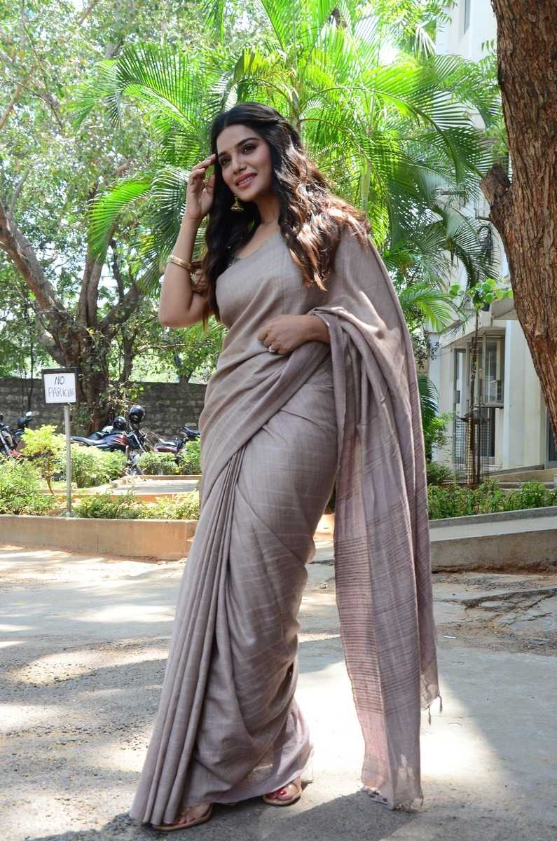 Aathmika in a beige saree at Vijayaraghavan trailer launch
