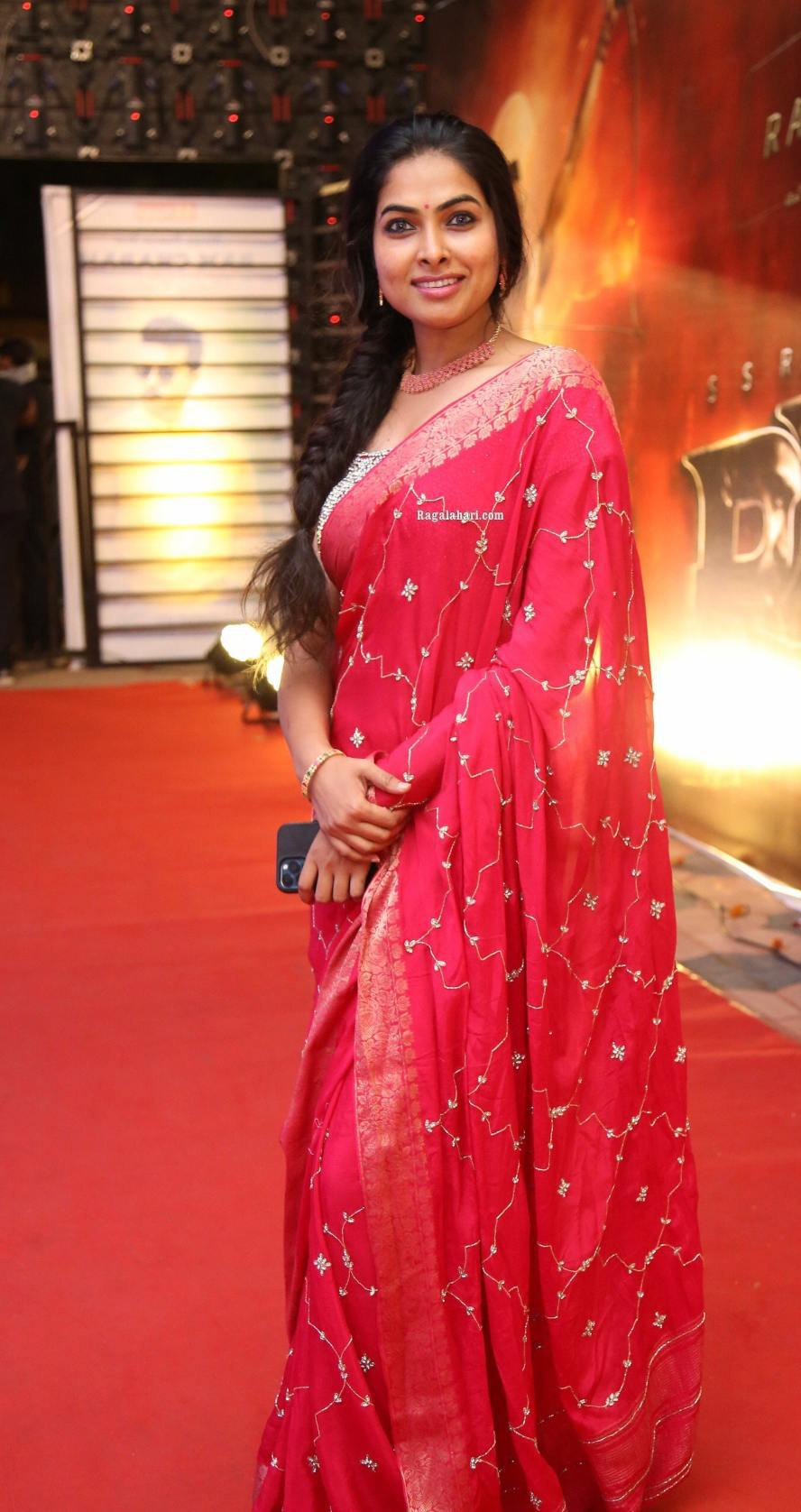 Divi Vadthya in a pink saree by Jahnavi Varma for Ramchran b'day celebrations