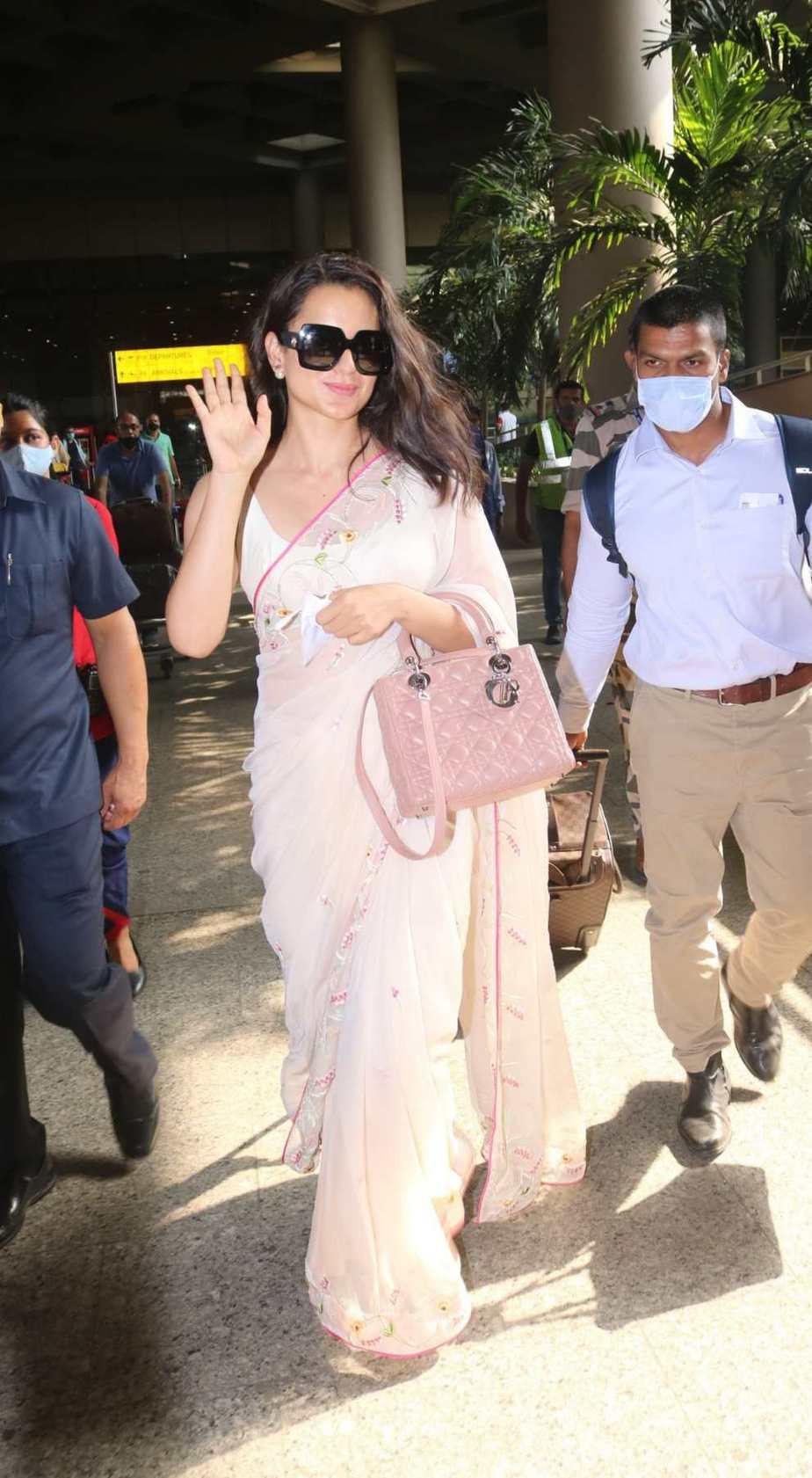 Kangana Ranaut spotted at airport arrival in pink saree