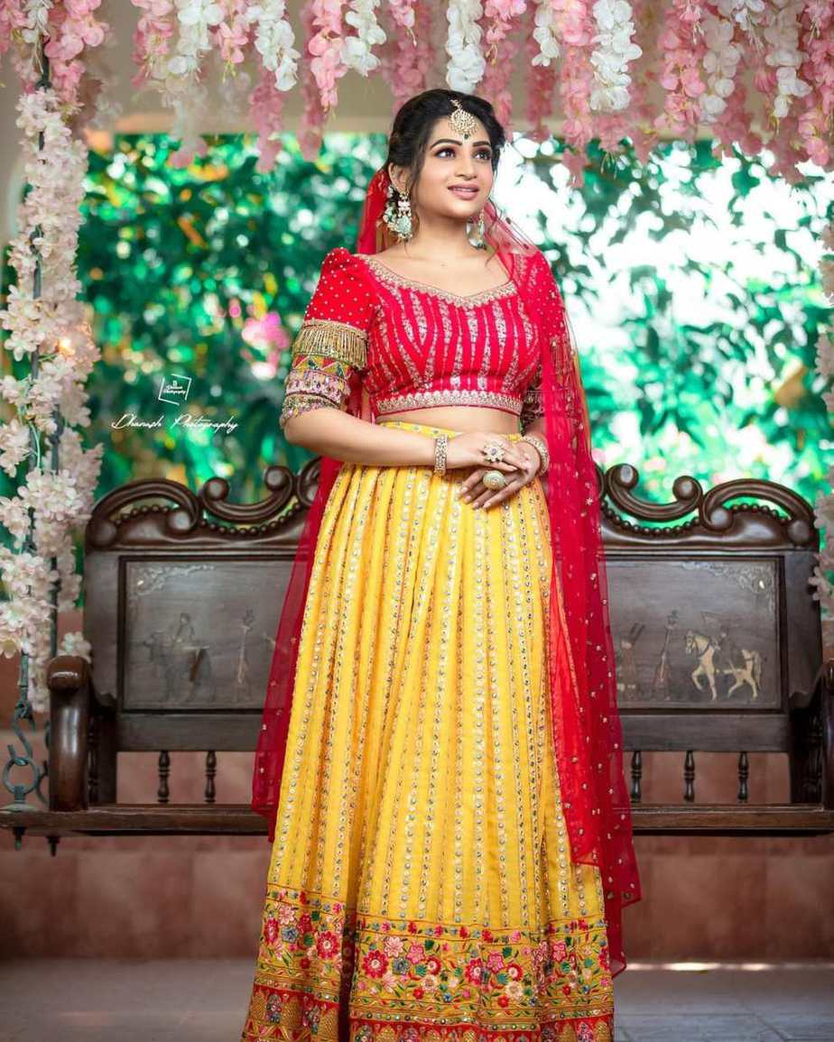 Nakshathra Nagesh in red-yellow lehenga by studio the design hub