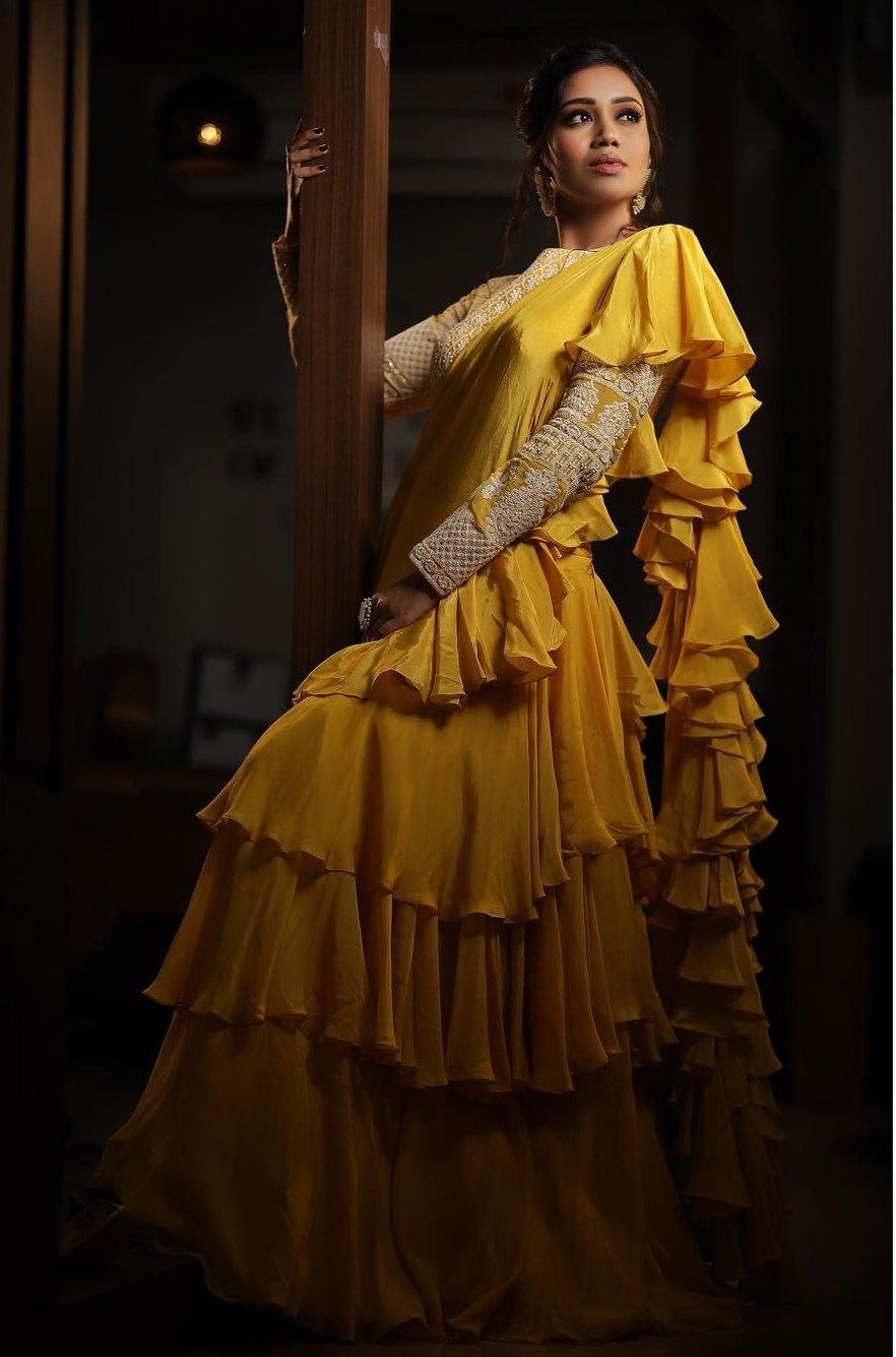 Nivetha Pethuraj in gold yellow ruffle lehenga by Indishree label-1