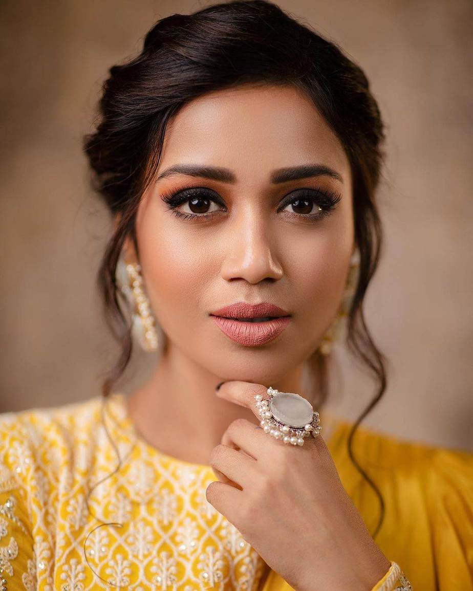 Nivetha Pethuraj in gold yellow ruffle lehenga by Indishree label-4