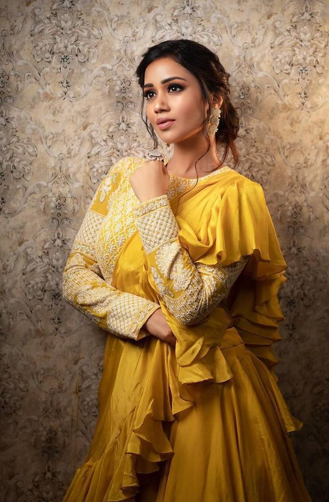Nivetha Pethuraj in gold yellow ruffle lehenga by Indishree label