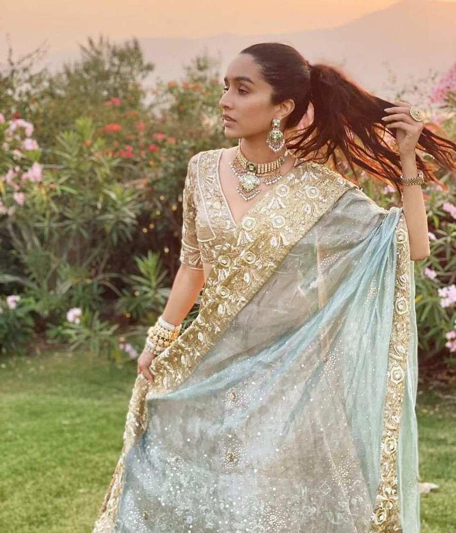 Shraddha Kapoor in gold and powder blue lehenga by Padmasitaa at priyaank sharma's wedding-3