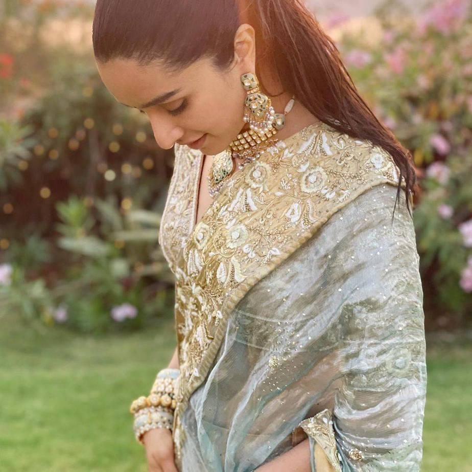 Shraddha Kapoor in gold and powder blue lehenga by Padmasitaa at priyaank sharma's wedding-5
