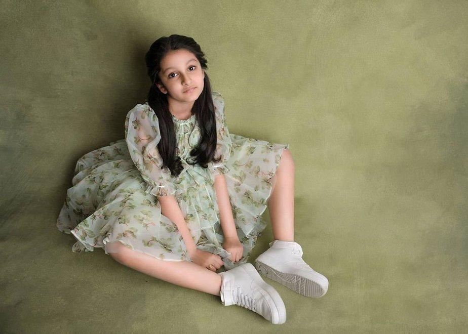 Sitara Ghattamaneni in a green dress by Janya's closet