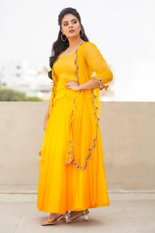 Sreemukhi in a yellow outfit by Anitha Sagar Tenali for wild dog press meet