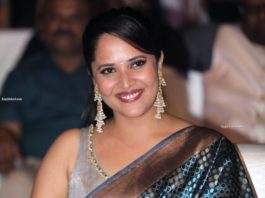 anasuya bharadwaj at chaavu kabaru challaga prerelease in blue saree