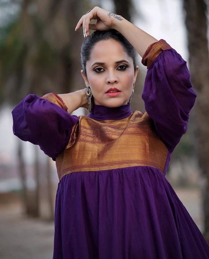 anasuya bharadwaj in a purple maxi dress
