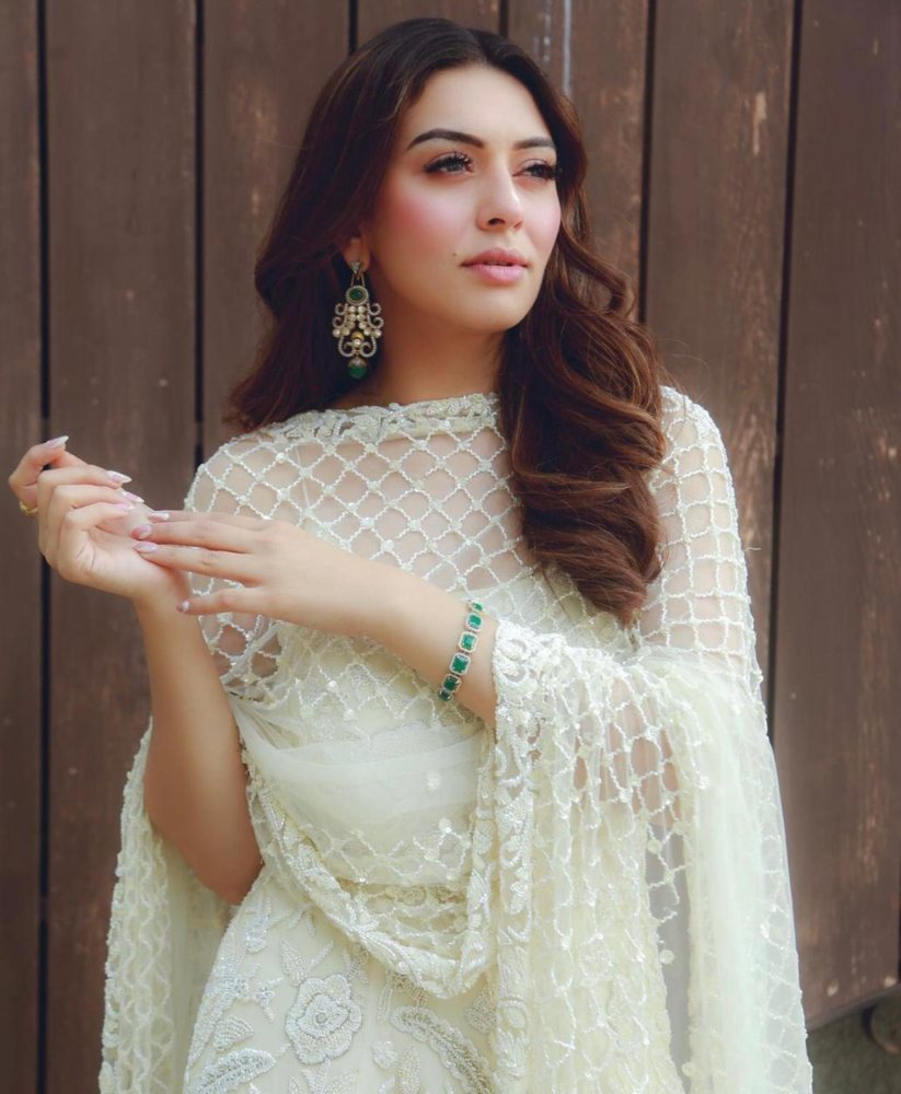 hansika motwani in an all-white suit from the label Premya