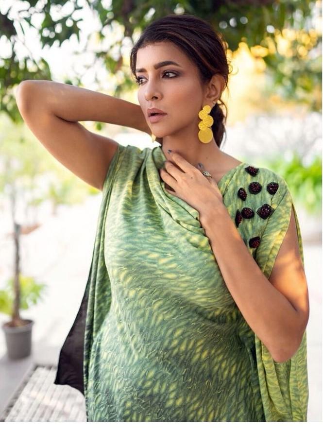 lakshmi manchu in a green yellow cowl top