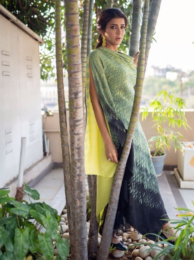 lakshmi manchu latest pics in a green and yellow cowl top