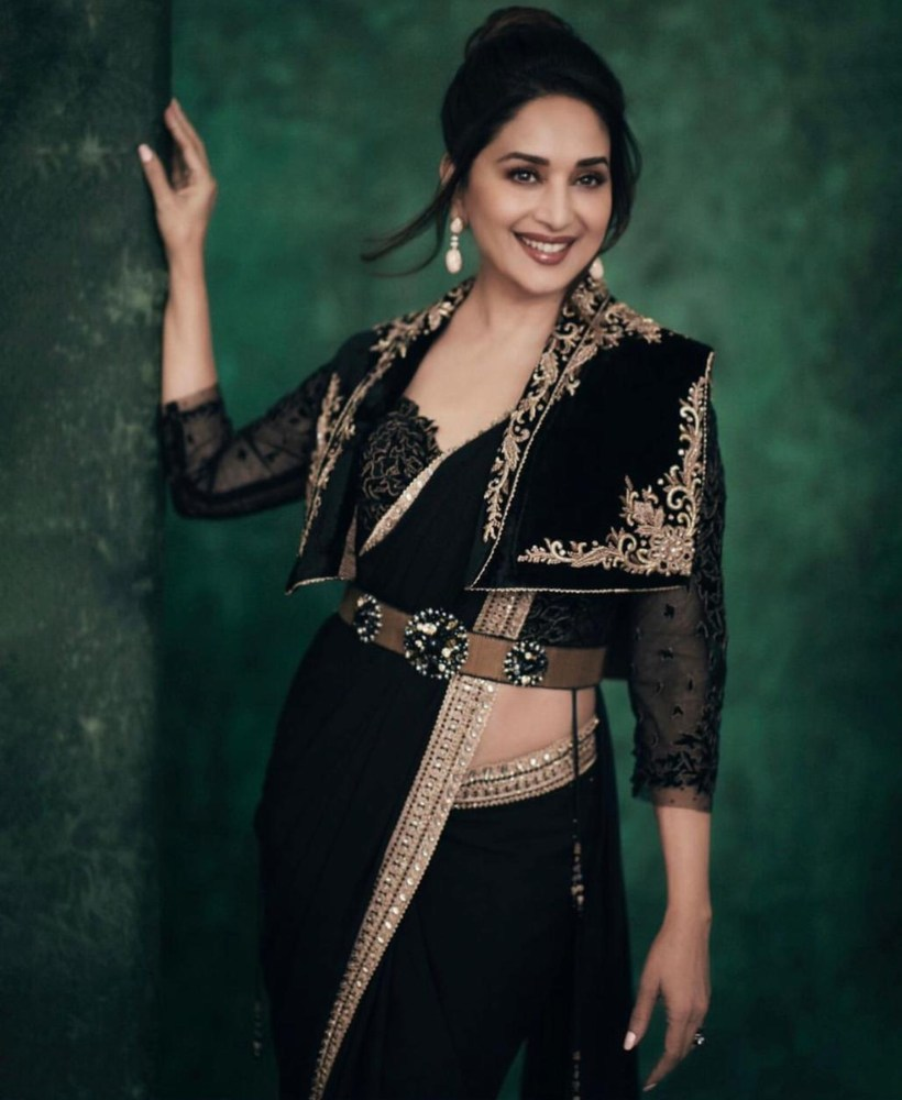 madhuri dixit in s black saree from the label Tarun tahiliani