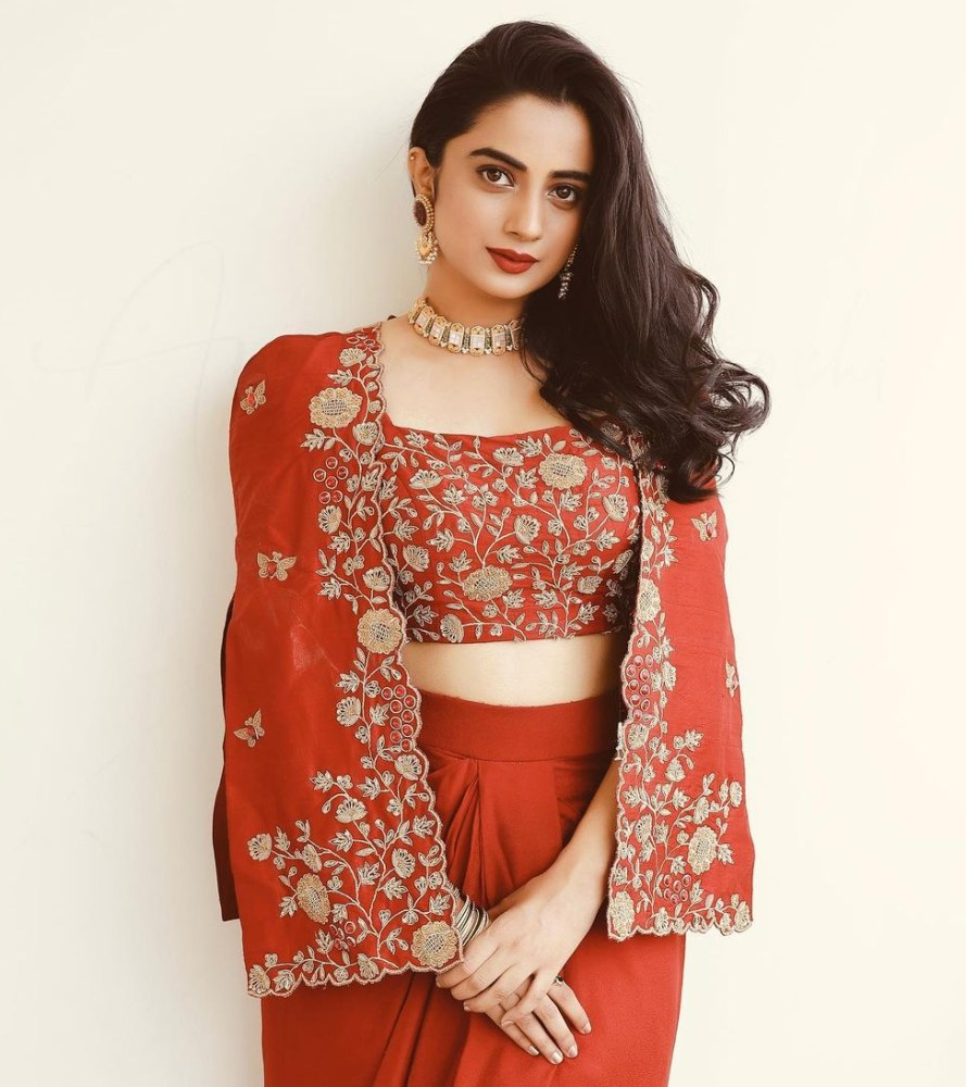 namitha pramod in a red embroidered jacket and skirt set