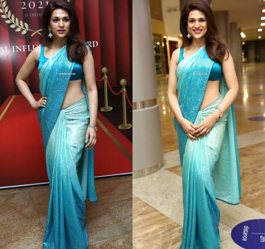 shraddha das in a blue sequin saree