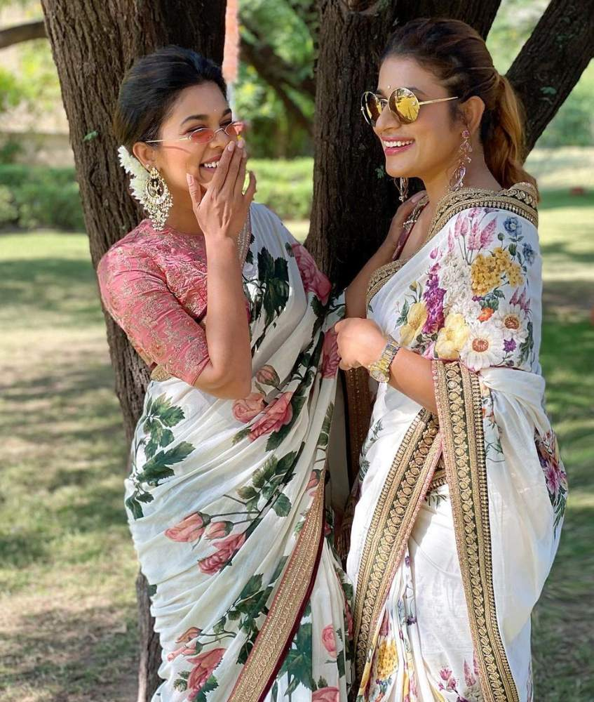 sreeja kalyan and sushmita konidela in sabyasachi floral sarees at niharika wedding