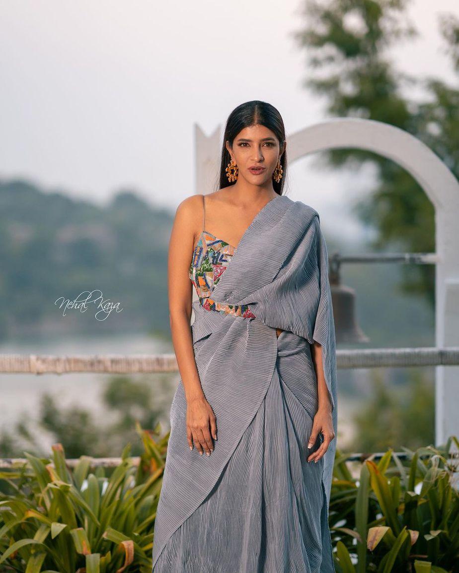 lakshmi manchu in a grey crushed saree