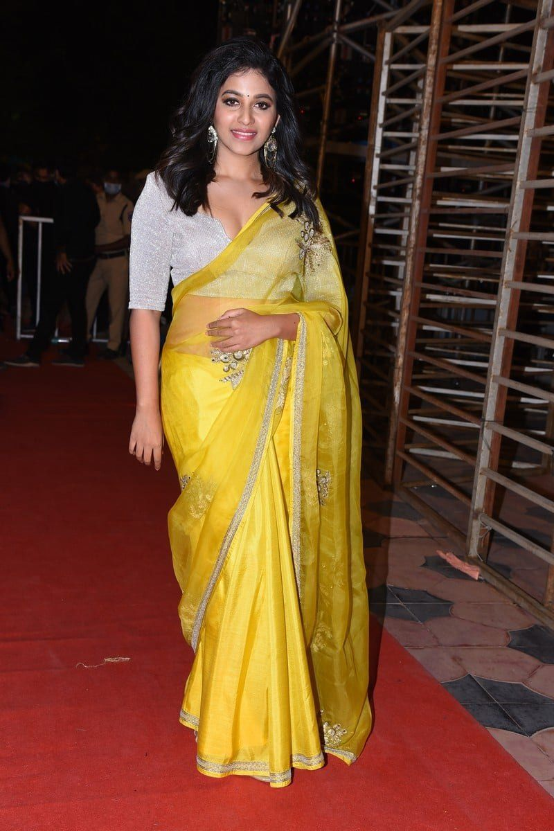 Anjali in a yellow saree for Vakeel saab pre release event