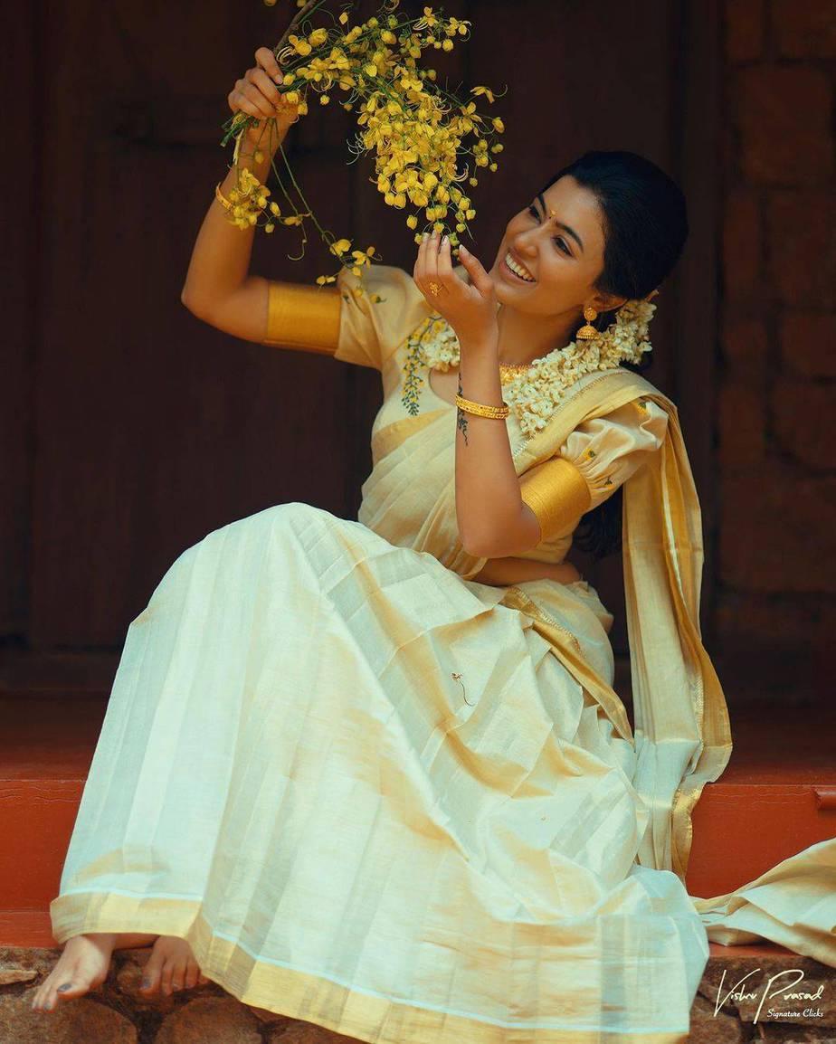 Anju Kurien in set half saree by Kukuntha
