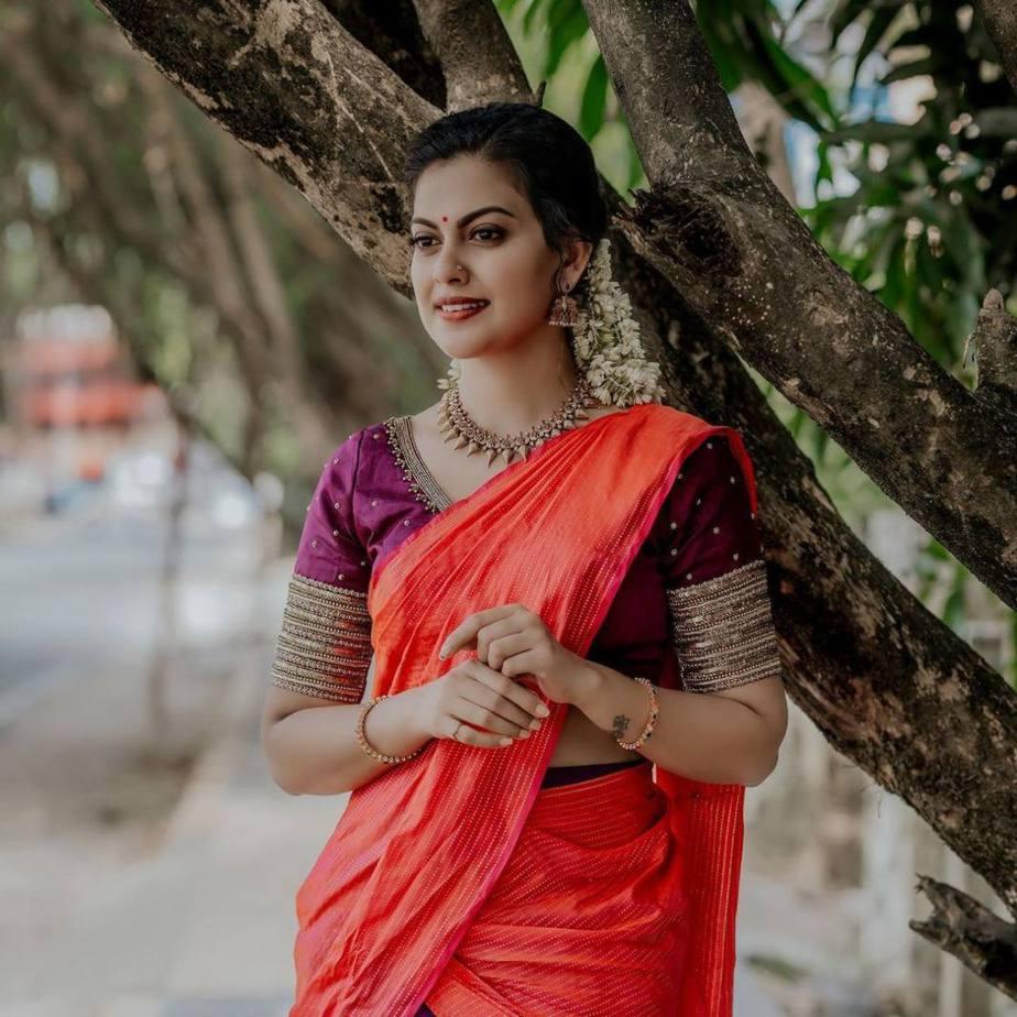 Anusree Nair in purple half saree by sabarinath for a wedding-2