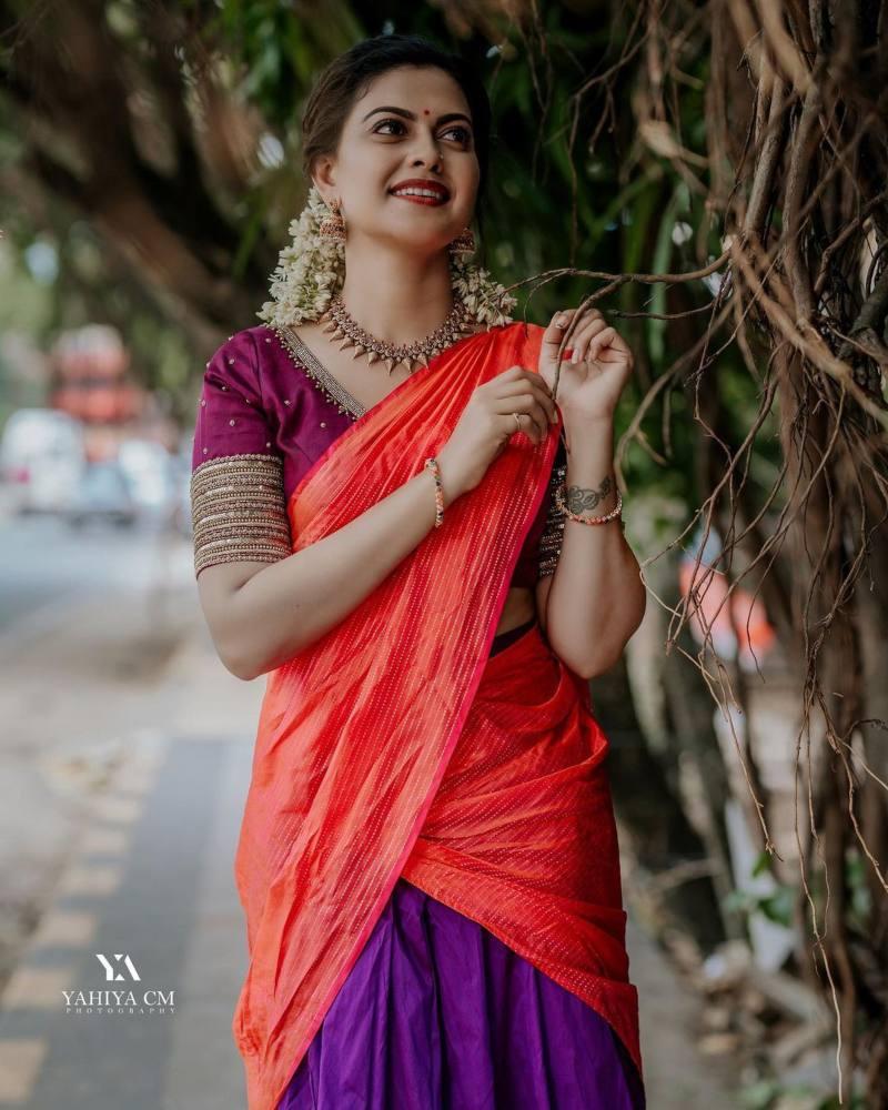 Anusree Nair in purple half saree by sabarinath for a wedding-3