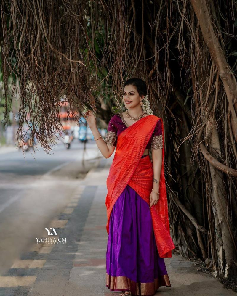 Anusree Nair in purple half saree by sabarinath for a wedding