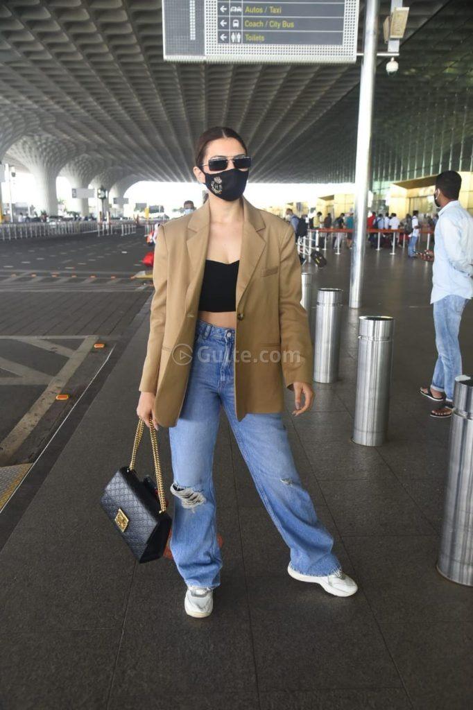 Hansika Motwani in coat -baggy jeans at airport-3