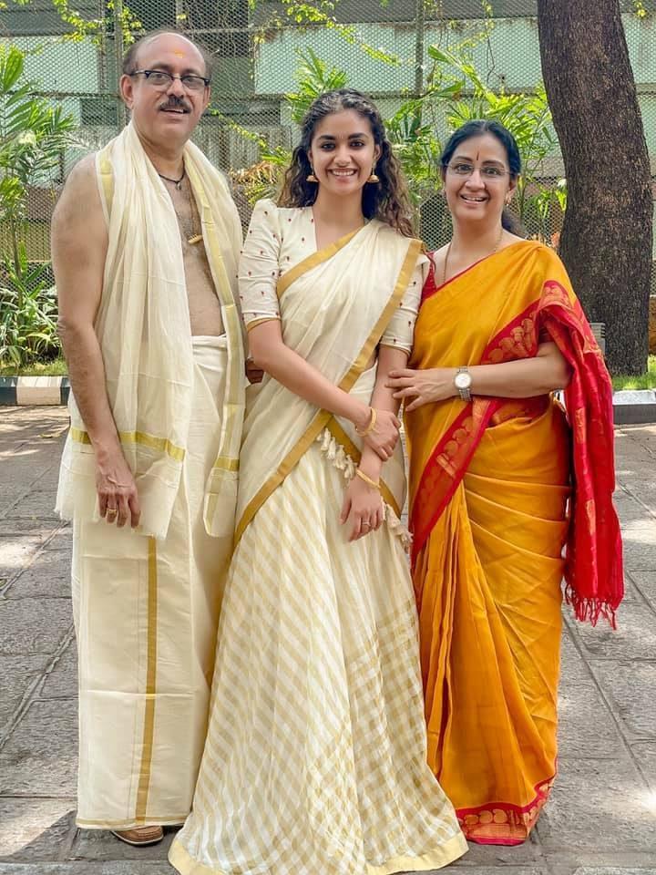 Keerthy Suresh in ivory half saree by poornima indrajith for guruvayur visit