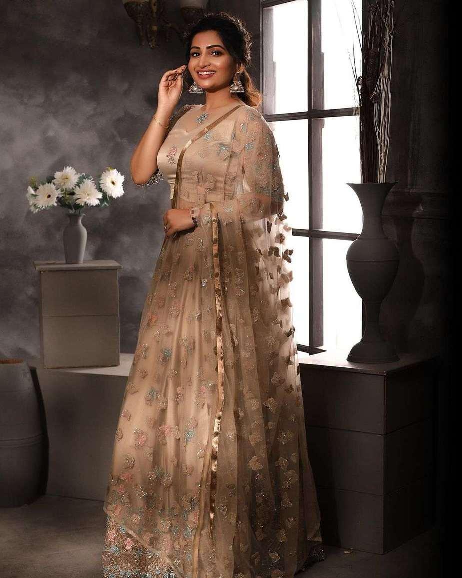 Nakshathra Nagesh in champagne gold lehenga by label evangelin