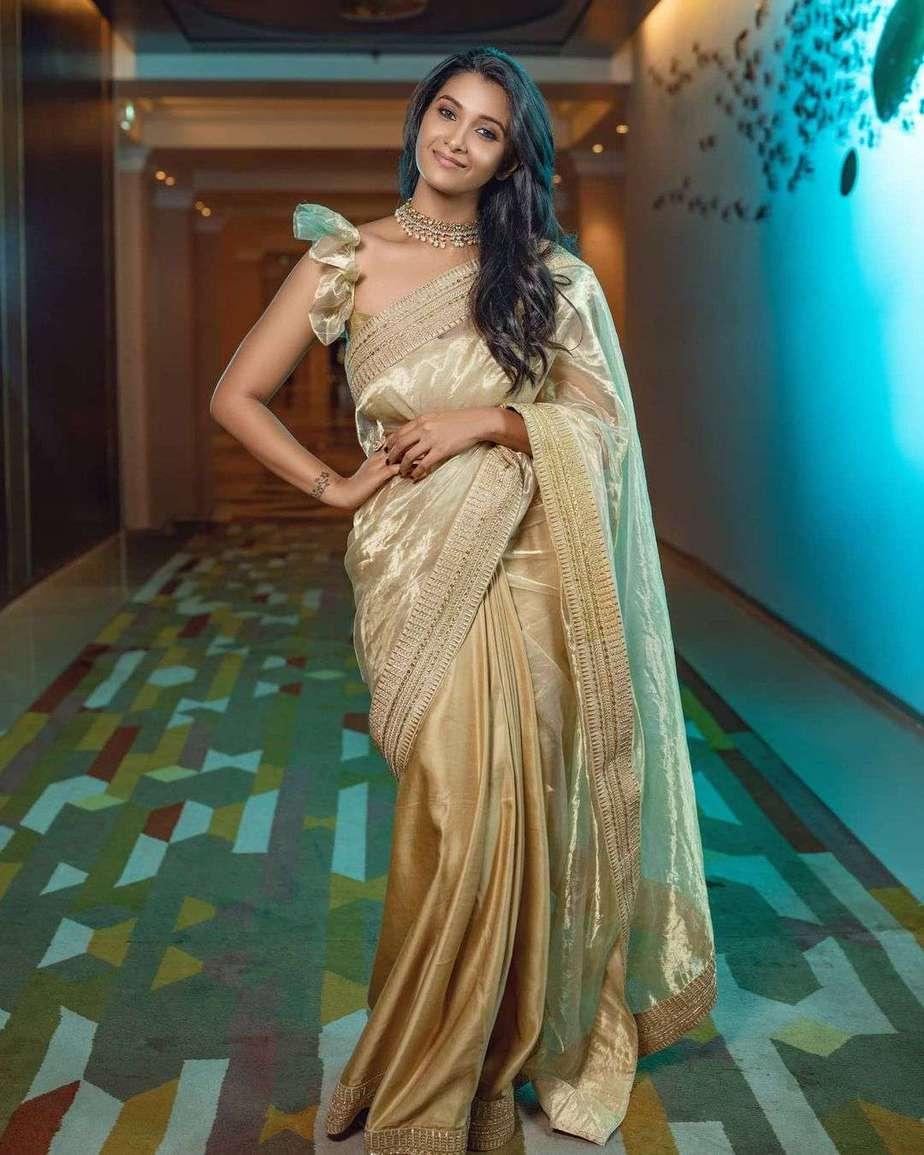 Priya Bhavani Shankar in gold saree by Ashwin Thiyagarajan