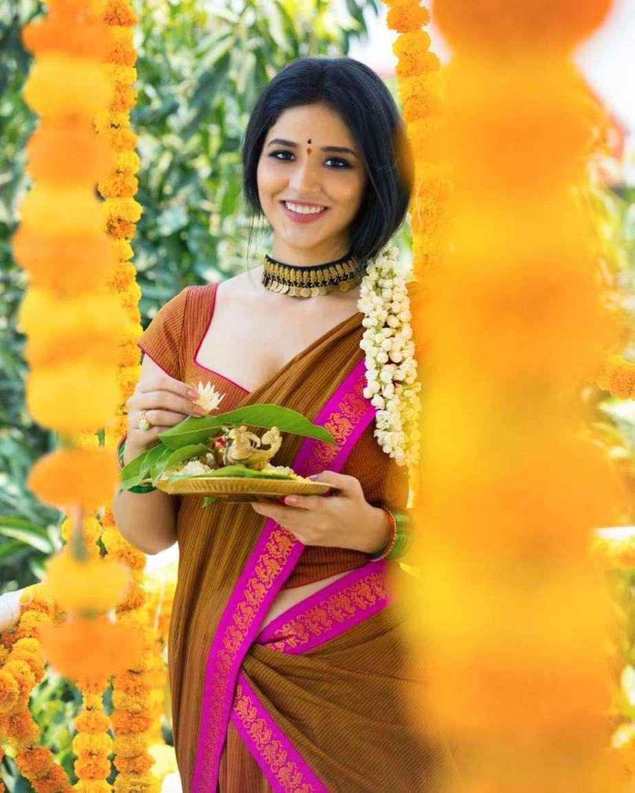 Priyanka Jawalkar in brick red half saree by Shravan kumar for Ugadi-2