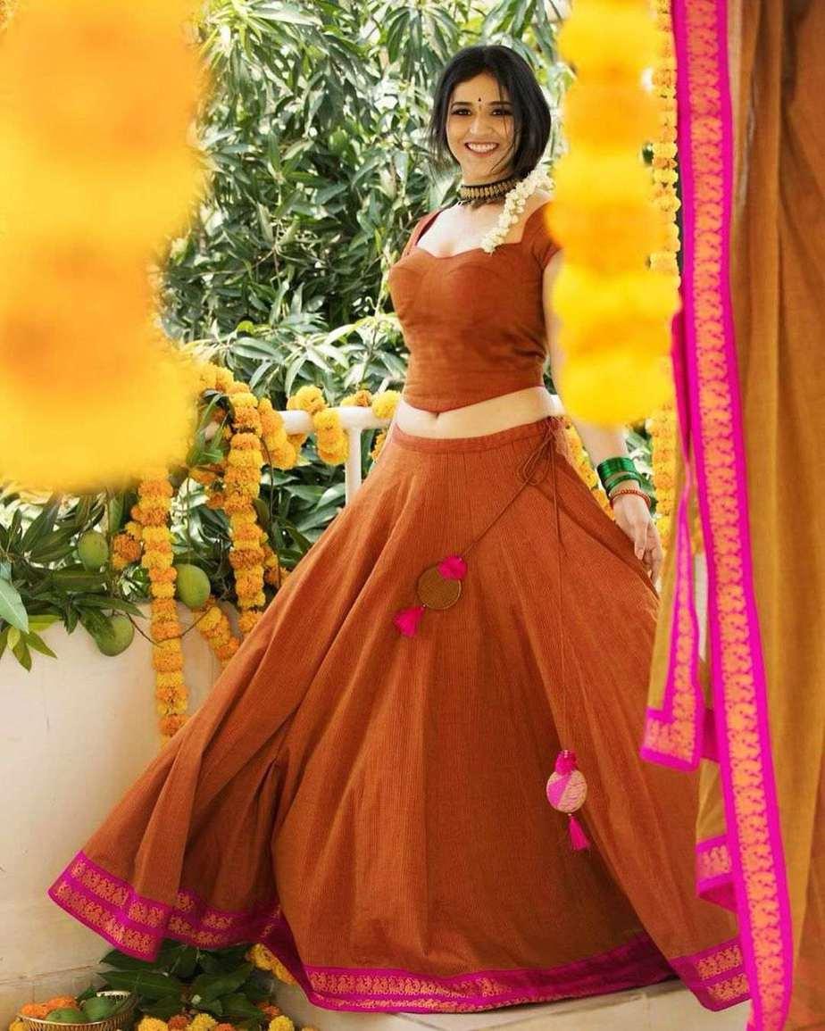 Priyanka Jawalkar in brick red half saree by Shravan kumar for Ugadi