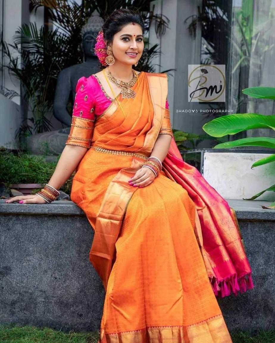 Sneha Prasanna in orange pattu saree for daughter's ayush homam ceremony-1