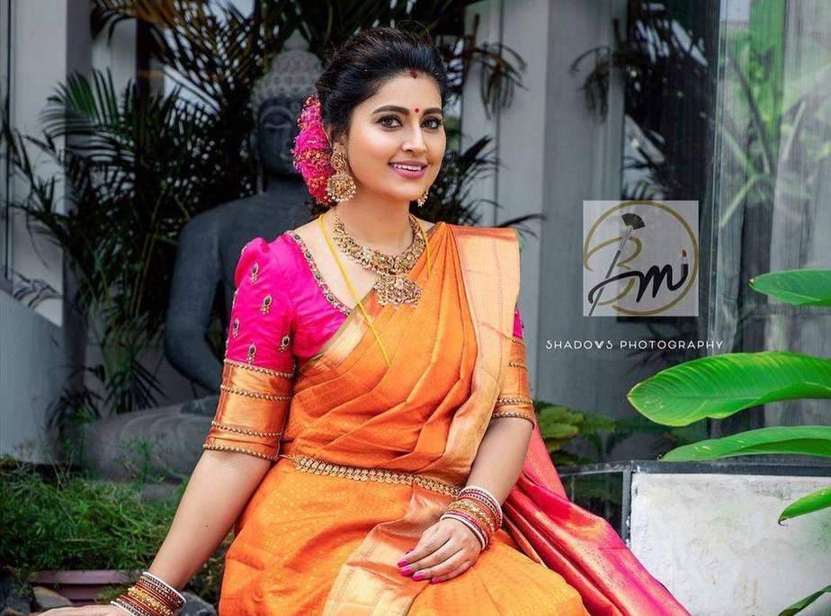 Sneha Prasanna in orange pattu saree for daughter's ayush homam ceremony-2