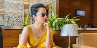 kangana in yellow saree at airport