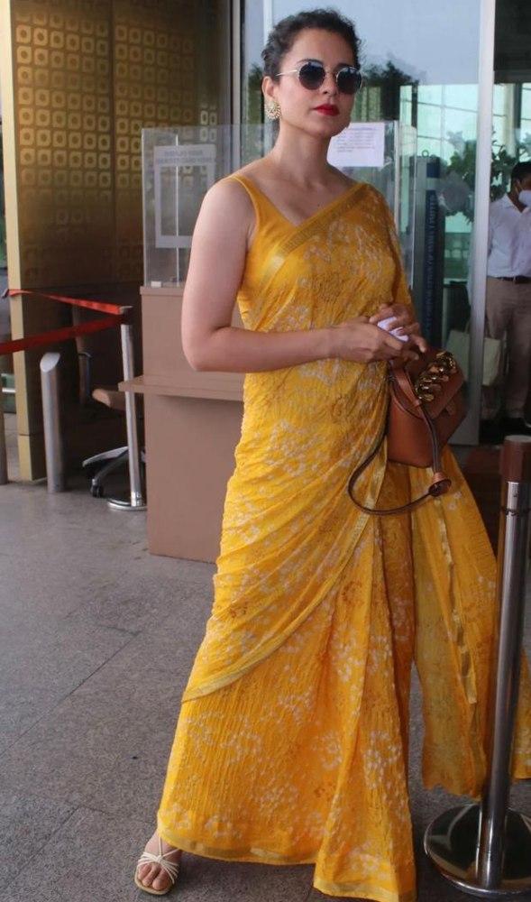 kangana in yellow saree at airport