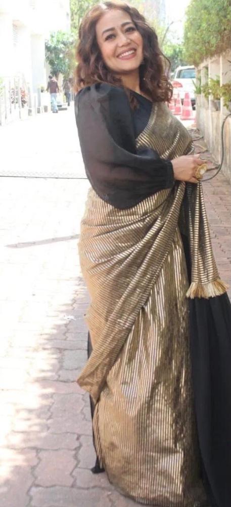 neha kakkar in golden black saree from the label rishi and vibhuti