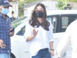 rashmika mandanna in white shirt and shorts