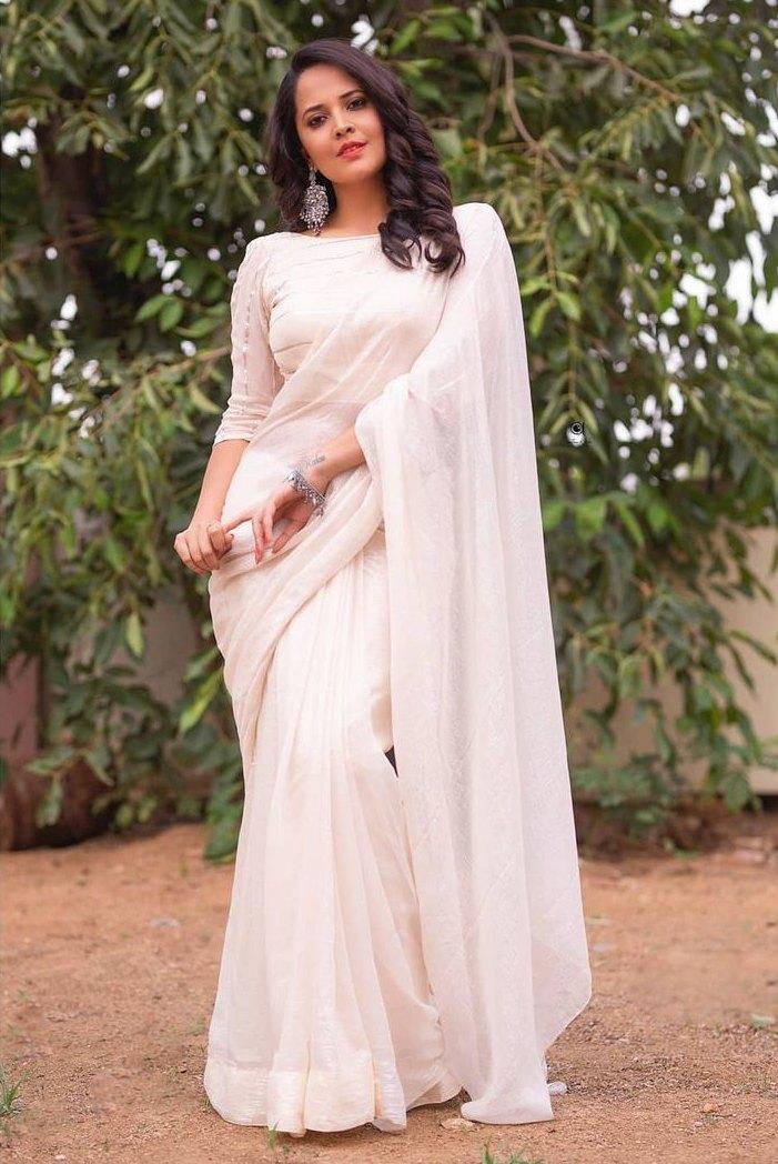 Anasuya Bharadwaj in a white saree by Vasavi for Jabardasth